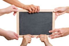 Many hands holding empty chalkboard Royalty Free Stock Image