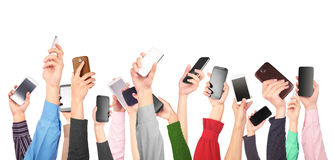 Many hands holding mobile phones. Isolated on a white backgroundn Royalty Free Stock Photos