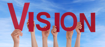 Many Hands Holding Vision. In the Sky stock images