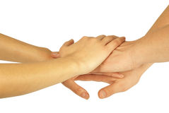 Many hands lying on top. Of each other royalty free stock photos