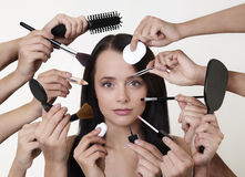 Many hands make light work. Woman doing make up with many hands and arms helping her get the job done faster Stock Photography