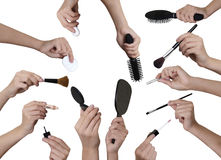 Many hands with make up equipment Stock Photo