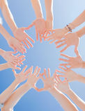 Many hands over blue sky background Royalty Free Stock Photos