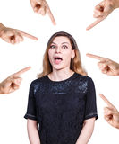 Many hands point on young surprised woman Royalty Free Stock Photo