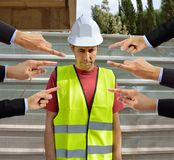 Many hands pointing the bullying a workman that is suffering mo. Bbing on concept of accusation guilty shy,and in concept of dismissal from work stock image