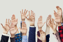 Many hands raised together Stock Photos