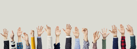 Many hands raised together. Up royalty free stock image