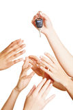 Many hands reaching for car keys royalty free stock photography