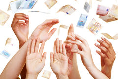 Many hands reaching for Euro Royalty Free Stock Photos