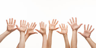Many hands reaching out in the air. White background, copy space