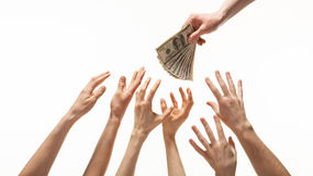 Many hands reaching out for money. White background