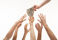 Many hands reaching out for money Stock Photos