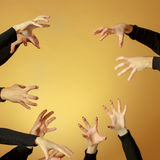 Many hands reaching out up in the air royalty free stock photos