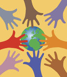 Many hands reaching out for the world. Vector illustration af eight colorful hands reaching for the world globe on orange background Royalty Free Stock Photography