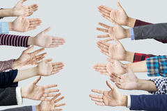 Many hands reaching sideways into stock photo