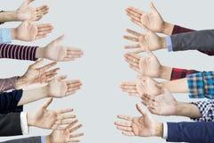 Many hands reaching sideways into Stock Photo
