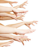 Many hands reaching sideways Stock Photo