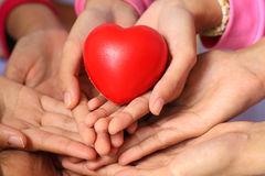 Many hands and a red heart Royalty Free Stock Images