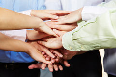 Many hands stacked for motivation royalty free stock photo