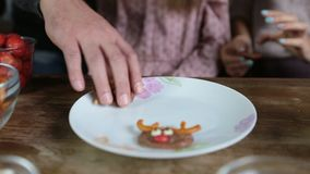 Many hands taking homemade sweets from the plate stock video