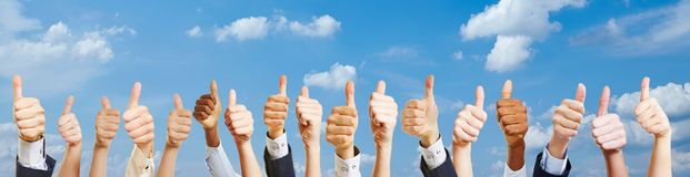Many hands with thumbs up royalty free stock images