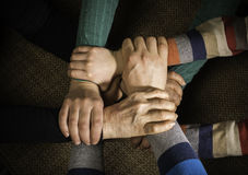 Many hands together. Interior shot royalty free stock photos