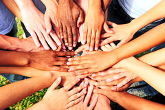 Many hands together: group of people joining hands stock photography