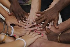 Many hands together: group of people joining hands. Many hands together: group of diverse people joining hands Royalty Free Stock Photos