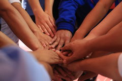 Many hands together: group of people joining hands Stock Photos