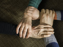Many hands together stock photography