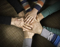 Many hands together. Interior shot royalty free stock image