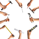 Many hands with tools Stock Photography