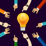 Many hands working together for an idea. a bulb lamp shine. concept of teamwork collaboration and participation in Royalty Free Stock Image