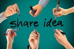Many hands writing share idea word Royalty Free Stock Photos