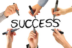 Many hands writing success word Royalty Free Stock Photo