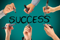 Many hands writing success word Stock Photography