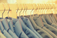 Many hangers in a row for clothes in the store. Royalty Free Stock Images