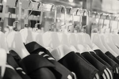 Many hangers in a row for clothes in the store. Royalty Free Stock Photo
