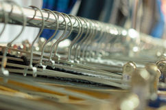 Many hangers in a row for clothes in the store. Royalty Free Stock Photography