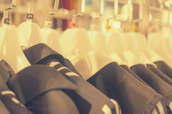 Many hangers in a row for clothes in the store. Stock Images