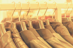 Many hangers in a row for clothes in the store. Stock Photo