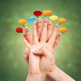 Many happy fingers with speech bubbles Royalty Free Stock Images