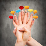 Many happy fingers with speech bubbles Royalty Free Stock Image