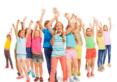 Many happy kids together raise hands up in the air Stock Photos