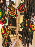 Many hats with the colors of the Jamaican flag for sale in the costume shop. Many hats with the colors of the Jamaican flag for sale in the costume or gift shop royalty free stock photo