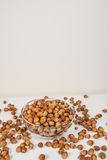 Many hazel nuts in glass bowl Stock Photography