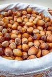 Many hazel nuts in wicker basket Royalty Free Stock Images