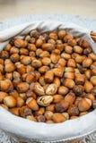 Many hazel nuts in wicker basket Stock Photo