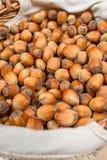 Many hazel nuts in wicker basket Royalty Free Stock Photos