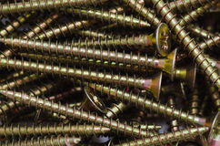 Many heap of metal screws backgrounds Stock Images